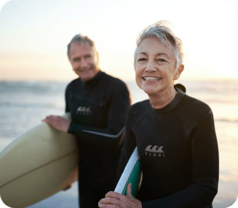 Two adults out surfing